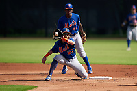 GCL Mets second baseman Nick Conti (27) catches a throw as shortstop Federico Polanco (44) backs up the play during a Gulf Coast League game against the GCL Astros on August 10, 2019 at FITTEAM Ballpark of the Palm Beaches Training Complex in Palm Beach, Florida.  GCL Astros defeated the GCL Mets 8-6.  (Mike Janes/Four Seam Images)