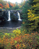 Pattison State Park, WI<br /> Little Manitou falls on the Black river with hardwood forest in autumn colors