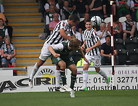 Dougie Imrie fouls David Wotherspoon in the St Mirren v Hibernian Clydesdale Bank Scottish Premier League match played at St Mirren Park, Paisley on 18.8.12.