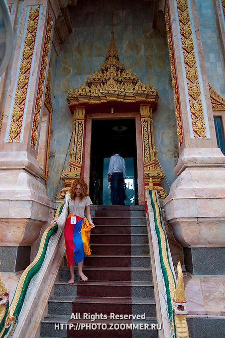 Girl inside Wat Chalong buddist temple in Phuket, Thailand