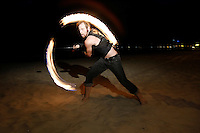 Friday, May 22 2009, San Diego, CA, USA:  Keane Carlson puts on a fireshow for beach goers on the sand near Pacific Beach Drive at the start of the Memorial Day Weekend.
