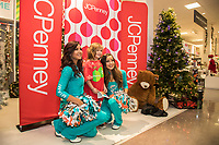Miami Dolphins Kenny Stills and Michael Thomas and the Dolphins Cheerleaders team up with JCPenney to give joy this holiday season and support kids and families from the YMCA of South Florida on Tuesday, Dec. 12, 2017, in Plantation, Fla. (Jesus Aranguren/AP Images for JCPenney)