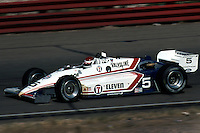 PHOENIX, AZ - APRIL 15: Bobby Rahal drives his March 84C 11/Cosworth at the Dana Jimmy Bryan 150 IndyCar race on April 15, 1984, at Phoenix International Raceway near Phoenix, Arizona.