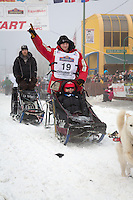 Dallas Seavey and team leave the ceremonial start line at 4th Avenue and D street in downtown Anchorage during the 2013 Iditarod race. Photo by Jim R. Kohl/IditarodPhotos.com