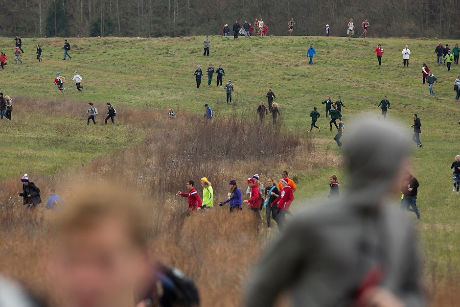 Fans run across the grounds to reposition themselves to catch another glimpse of the runners during the NCAA Cross Country Championships in Terre Haute, Ind. on Saturday, Nov. 22, 2014. (James Brosher, Special to the Denver Post)