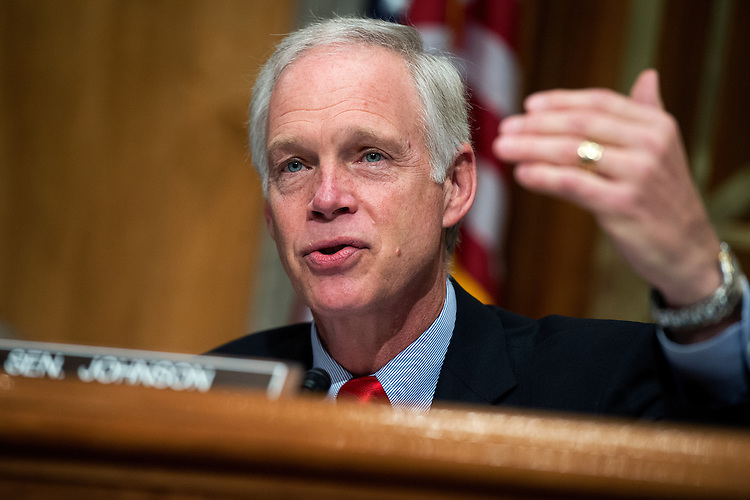 "UNITED STATES - JUNE 17: Chairman Ron Johnson, R-Wisc., makes an opening statement during a Senate Homeland Security and Governmental Affairs Committee hearing in Dirksen Building titled ""Governing Through Goal Setting: Enhancing the Economic and National Security of America,"" June 17, 2015. Former Sen. Joseph Lieberman, I-Conn., and former Gov. Jon Huntsman Jr., R-Utah, co-chairs of No Labels, also testified. (Photo By Tom Williams/CQ Roll Call)"