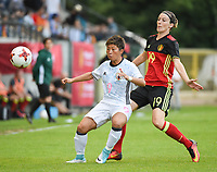 20170613 - LEUVEN ,  BELGIUM : Belgian Imke Courtois (R) and Japanese Kumi Yokoyama (L) pictured during the female soccer game between the Belgian Red Flames and Japan , a friendly game before the European Championship in The Netherlands 2017  , Tuesday 13 th Juin 2017 at Stadion Den Dreef  in Leuven , Belgium. PHOTO SPORTPIX.BE | DIRK VUYLSTEKE