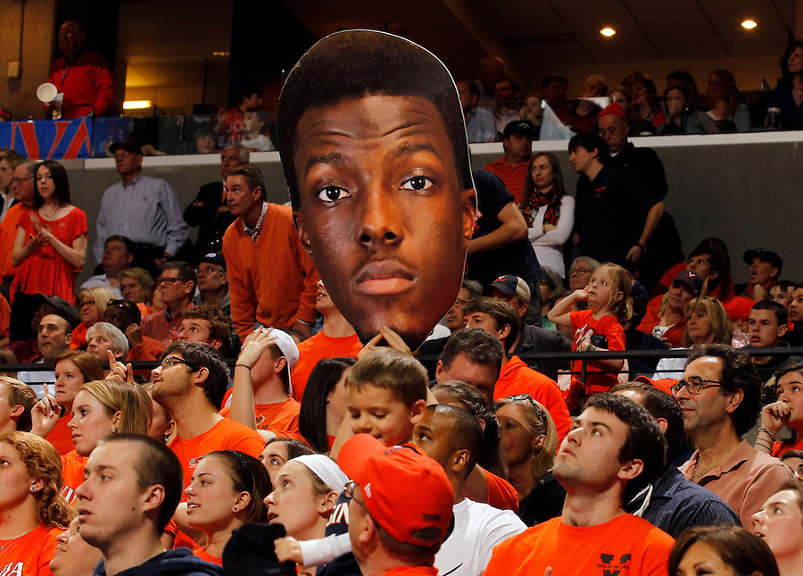 Virginia fans hold up a sign of Virginia guard Teven Jones (5) during the game Saturday, February 22, 2014,  in Charlottesville, VA. Virginia won 70-49.