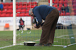 St Johnstone v Dundee United.....29.12.13   SPFL<br /> A hole in the nets after Stevie May's second goal is repaired by groundsman Chris Smith<br /> Picture by Graeme Hart.<br /> Copyright Perthshire Picture Agency<br /> Tel: 01738 623350  Mobile: 07990 594431