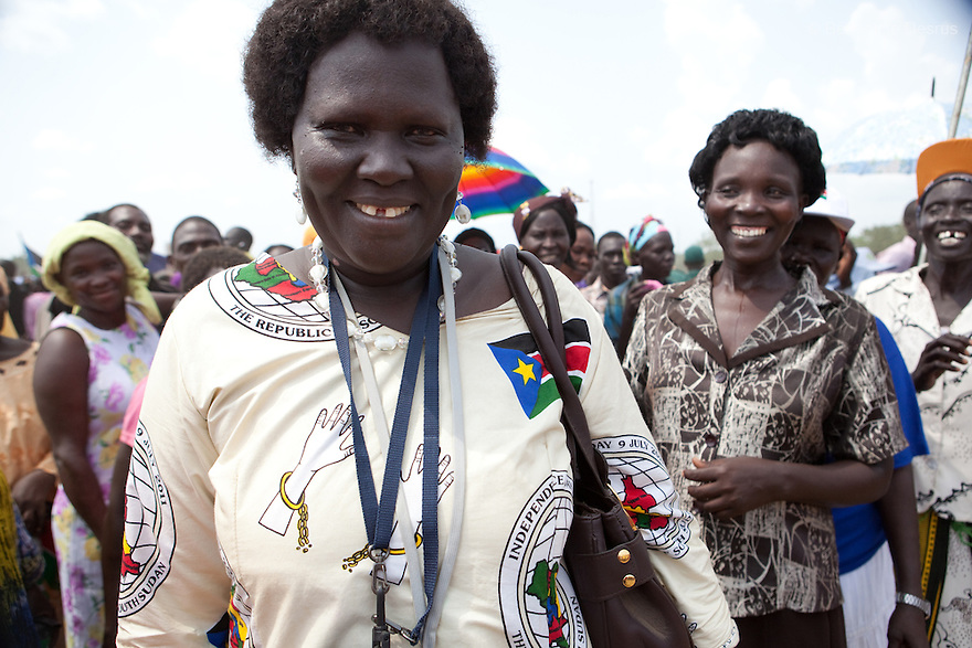 """Saturday 9 july 2011 - Juba, Republic of South Sudan - A South Sudanese woman wears a dress made with a """"independence day"""" fabric during South Sudan's independence day celebrations in Juba. Tens of thousands of citizens of the new South Sudan celebrate national independence but whether statehood will resolve issues of identity after a decades-long war remains to be seen. Photo credit: Benedicte Desrus"""