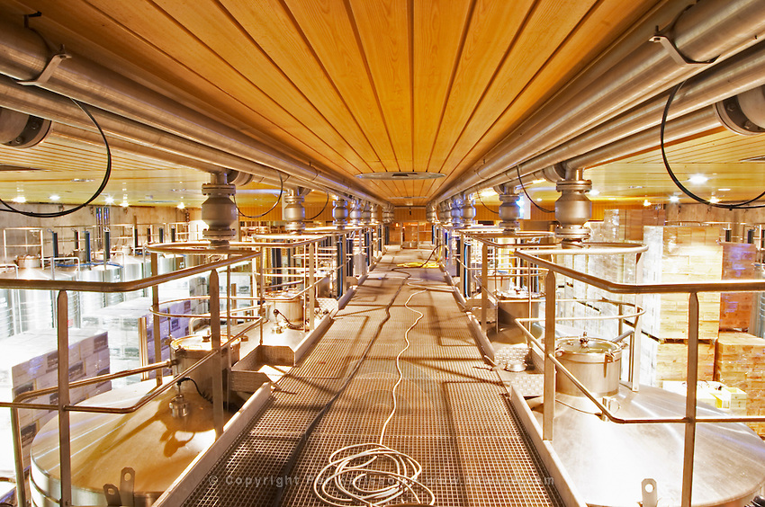 A view over the top of the fermentation tanks in the winery, looking a bit like a food processing factory...  Domaine E Guigal, Ampuis, Cote Rotie, Rhone, France, Europe