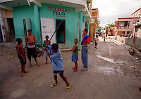 Children play baseball in the streets with the hope of one day making a living playing the sport.