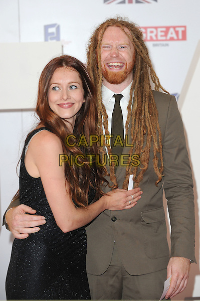 guest & Newton Faulkner.The UK Creative Industries Reception supported by The Founders Forum, at the Royal Academy of Arts, London, as part of HM Government's GREAT campaign alongside the very best of the UK Creative Industries from the fields of music, film, art and entertainment..30th July 2012 .half length green suit dreadlocks hair dress black beard facial hair smiling arms around waist.CAP/BEL.©Tom Belcher/Capital Pictures.