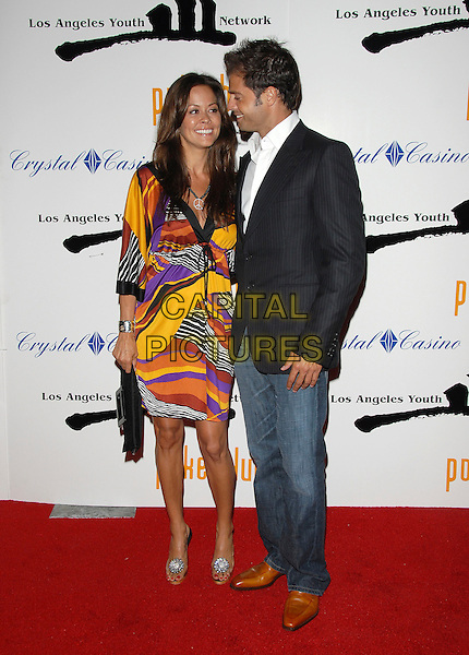 BROOKE BURKE & DAVID CHARVET.attend The Celebrity Poker Tournament benefitting The Los Angeles Youth Network held at The Crystal Casino in Compton, LA, California, USA, September 9th 2006..full length couple pregnant patterned print dress.Ref: DVS.www.capitalpictures.com.sales@capitalpictures.com.©Debbie VanStory/Capital Pictures