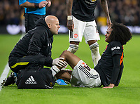 4th January 2020; Molineux Stadium, Wolverhampton, West Midlands, England; English FA Cup Football, Wolverhampton Wanderers versus Manchester United; Tahith Chong of Manchester United on the grass receiving treatment after a foul from Maximilian Kilman of Wolverhampton Wanderers - Strictly Editorial Use Only. No use with unauthorized audio, video, data, fixture lists, club/league logos or 'live' services. Online in-match use limited to 120 images, no video emulation. No use in betting, games or single club/league/player publications