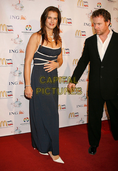 BROOKE SHIELDS & CHRIS HENCHY.2nd Annual Noche de Ninos Gala benefiting Children's Hospital Los Angeles held at the Beverly Hilton Hotel, .Beverly Hills, California, USA,.07 October 2006..full length married husband wife couple blue and white dress hand on tummy.Ref: ADM/RE.www.capitalpictures.com.sales@capitalpictures.com.©Russ Elliot/AdMedia/Capital Pictures.