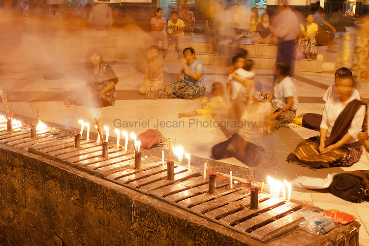 Buddhist fallowers praying at Shwedagon pagoda at night