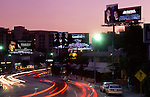 Movie billboards depicting major male film stars on the Sunset Strip in Los Angeles, CA circa 1990