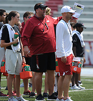 NWA Democrat-Gazette/ANDY SHUPE<br /> Arkansas coach Bret Bielema (center) speaks to players alongside assistant coach Barry Lunney Saturday, Aug. 5, 2017, prior to the start of a scrimmage in Razorback Stadium in Fayetteville. Visit nwadg.com/photos to see more photographs from the practice.