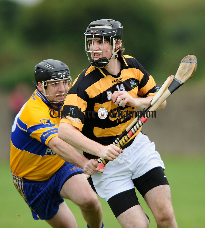 Tubber's Shane O Connor gets away from Sixmilebridge's Chtristy Griffin during their championship game at Tulla. Photograph by John Kelly.