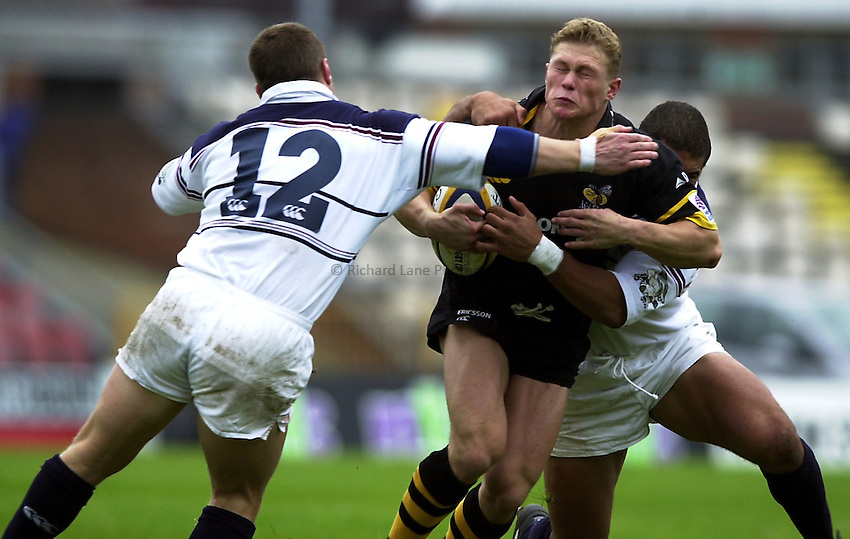 Photo. Richard Lane. .Swansea v Wasps, Heineken Cup Pool 6. 7/10/2000..Josh Lewsey is caught by Scott Gibbs and colin Charvis.