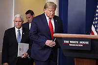 United States President Donald J. Trump arrives to speak during a press conference with members of the coronavirus task force in the Brady Press Briefing Room of the White House on March 24, 2020 in Washington, DC.  US Vice President Mike Pence follows behind.<br /> Credit: Oliver Contreras / Pool via CNP/AdMedia