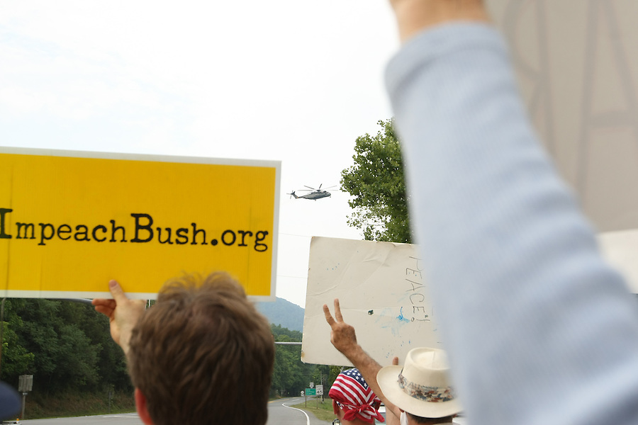A crowd awaits the arrival of President Bush.