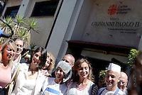 Roma, 15 Agosto 2016<br /> Virginia Raggi con ospiti e volontari Caritas<br /> Pranzo alla mensa Caritas di Colle Oppio