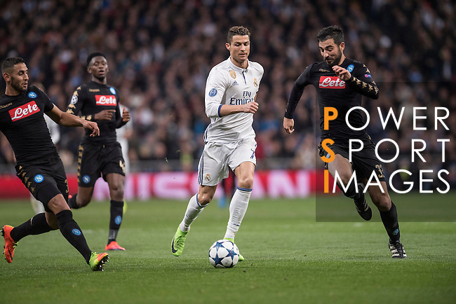 Cristiano Ronaldo of Real Madrid  runs with the ball during the match Real Madrid vs Napoli, part of the 2016-17 UEFA Champions League Round of 16 at the Santiago Bernabeu Stadium on 15 February 2017 in Madrid, Spain. Photo by Diego Gonzalez Souto / Power Sport Images