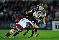 Jonathan Spratt of the Ospreys looks to offload the ball after being tackled. European Rugby Champions Cup match, between the Ospreys and Bordeaux Begles on December 12, 2015 at the Liberty Stadium in Swansea, Wales. Photo by: Patrick Khachfe / JMP
