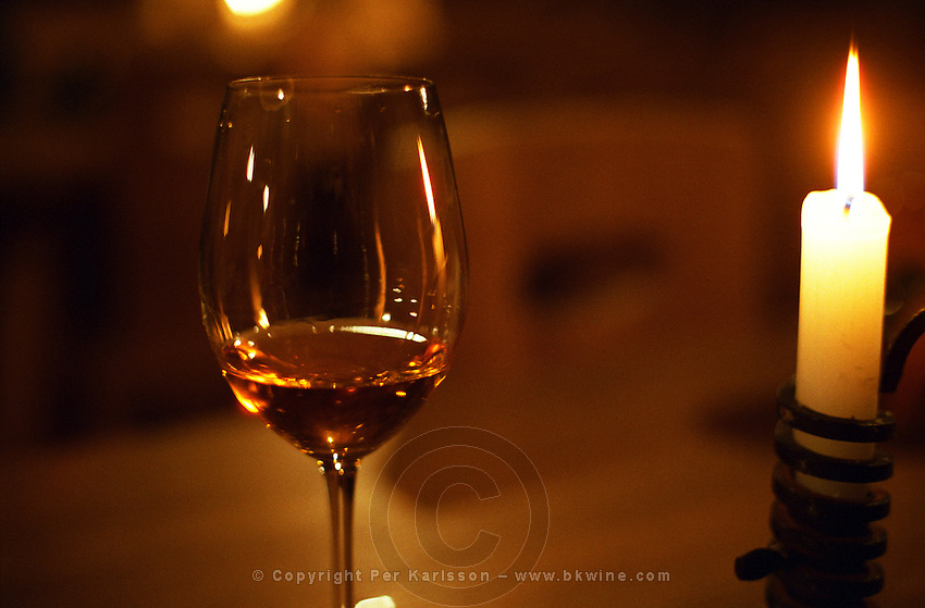 "The Kiralyudvar winery: a glass of tokaj and a candle in the underground tasting room. Kiralyudvar (meaning ""King's Court"")is run by Istvan Szepsy, considered maybe the best winemaker in Tokaj. he also makes Tokaj under his own name.  Credit Per Karlsson BKWine.com"