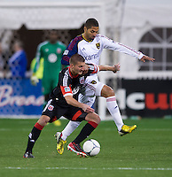 Perry Kitchen (23) of D.C. United fights for the ball with Alvaro Saborio (15) of Real Salt Lake during the game at RFK Stadium in Washington, DC.  D.C. United defeated Real Salt Lake, 1-0.