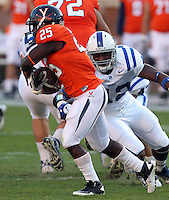 CHARLOTTESVILLE, VA- NOVEMBER 12:  Defensive end Dezmond Johnson #42 of the Duke Blue Devils puts pressure on running back Kevin Parks #25 of the Virginia Cavaliers during the game on November 12, 2011 at Scott Stadium in Charlottesville, Virginia. Virginia defeated Duke 31-21. (Photo by Andrew Shurtleff/Getty Images) *** Local Caption *** Dezmond Johnson;Kevin Parks
