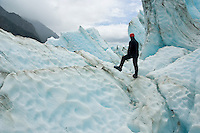 Ice climber looking at glacier, Franz Josef Glacier, New Zealand