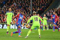Wilfried Zaha of Crystal Palace and Alberto Moreno of Liverpool during the EPL - Premier League match between Crystal Palace and Liverpool at Selhurst Park, London, England on 29 October 2016. Photo by Steve McCarthy.