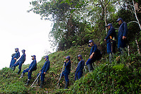 A group of coca plants eradication wait for instructions during a coca plant eradication program at the Antioquia mountains In Colombia so far this year have been eradicated 900 hectares in the country, mainly in rural areas, there are about 2,500 men engaged in this work. According to the Presidential Program for Comprehensive Action against Antipersonnel Mines, between 1990 and January 31, 2012, have been affected by landmines l9.642 people, of these, 674 were injured in eradication. Medellín, July 3 of 2012. Photo by Fredy Amariles/ VIEWpress.