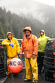 CANADA, Vancouver, British Columbia, portrait of the Captain Steve Johansen, First Mate Frank Keitsch and Deck Hand Peter Chaucer aboard the shrimp boat Organic Ocean