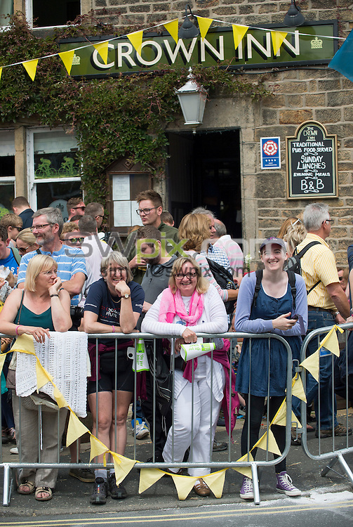 Picture by Allan McKenzie/SWpix.com - 06/07/2014 - Cycling - Tour de France 2014 - Stage 2, York to Sheffield - Yorkshire, England - Crowds outside The Crown pub in Addingham after the tour came to the village.