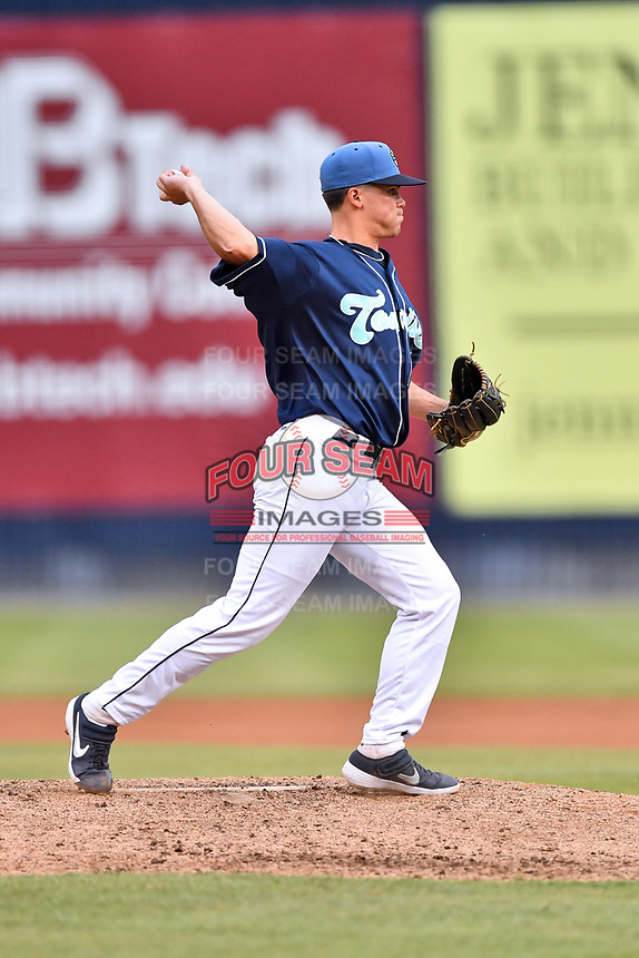 Asheville Tourists relief pitcher Boby Johnson (22) attempts a pickoff during a game against the Augusta GreenJackets at McCormick Field on July 13, 2019 in Asheville, North Carolina. The GreenJackets defeated the Tourists 6-4. (Tony Farlow/Four Seam Images)