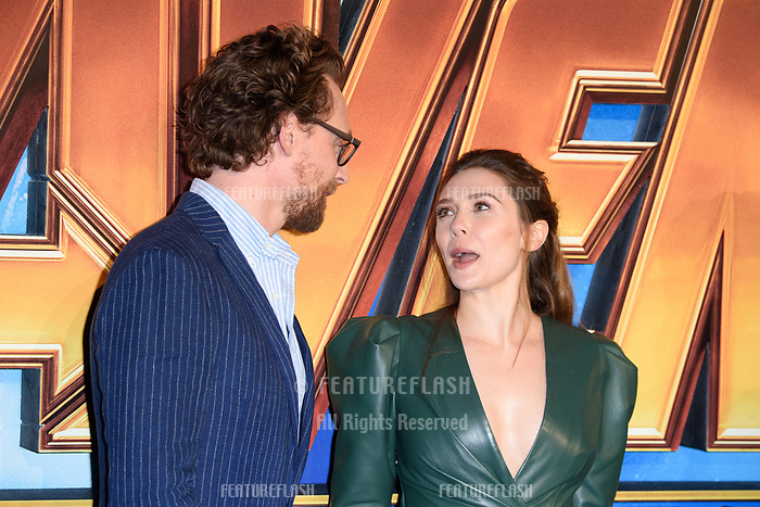 Tom Hiddleston &amp; Elizabeth Olsen arriving for the &quot;Avengers: Infinity War&quot; fan event at the London Television Studios, London, UK. <br /> 08 April  2018<br /> Picture: Steve Vas/Featureflash/SilverHub 0208 004 5359 sales@silverhubmedia.com