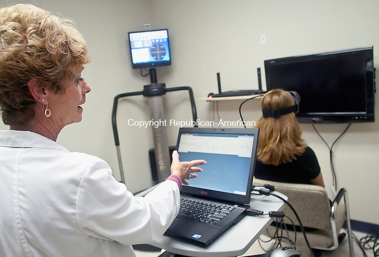 WATERBURY, CT.-28 SEPTEMBER 2010 092810DA02 - Otolaryngology tech Elaine Hazelton, left, explains the results of a balance test taken from Jennifer Micacci, right, on a videonystagmography machine at Ear Nose &amp; Throat Associates Of Waterbury PC on Tuesday. <br /> Republican-American  Darlene Douty