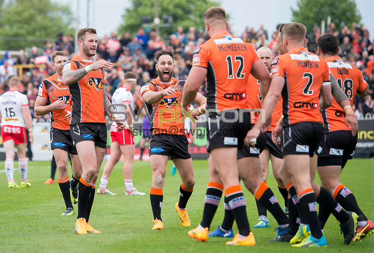 Picture by Allan McKenzie/SWpix.com - 13/05/2017 - Rugby League - Ladbrokes Challenge Cup - Castleford Tigers v St Helens - The Mend A Hose Jungle, Castleford, England - Castleford's Luke Gale reacts with delight as team mate Jake Webster touches down for his second try against St Helens.