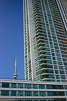 Condominiums on Yonge street and the CN Tower....The CN Tower, located in Toronto, Ontario, Canada, is the world's tallest freestanding structure on land, standing 553.33 meters (1,815 ft 5 in) tall. It is considered the signature icon of the city, attracting more than two million international visitors annually....Photo : Pierre Roussel - Images Distribution