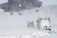 British Merlin helicopter practice in the Arctic, picking up loads in the terrain near Bardufoss, Norway. <br /> <br /> In 2019 the Arctic exercise Clockwork passed 50 years of training in Norway, and now has a permanent base within the Norwegian Air Force base at Bardufoss. <br /> <br /> 845 Naval Air Squadron is a squadron of the Royal Navy's Fleet Air Arm. Part of the Commando Helicopter Force, it is a specialist amphibious unit operating the Commando Merlin Mk3 helicopter and provides troop transport and load lifting support to 3 Commando Brigade Royal Marines.<br /> <br /> &copy;Fredrik Naumann/Felix Features