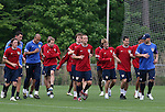 The U.S. team runs laps. From left: John O'Brien, Tim Howard, Eddie Lewis, non-roster practice player Michael Bradley, Jimmy Conrad, Bobby Convey, Carlos Bocanegra, and Marcus Hahnemann. Thursday, May 11th, 2006 at SAS Soccer Park in Cary, North Carolina. The United States Men's National Soccer Team held a training session as part of their preparations for the upcoming 2006 FIFA World Cup Finals being held in Germany.