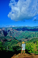 Tourist gazes at Waimea Canyon