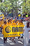Urban Los Angeles NAMI _National Alliance for Mental Health_group carries sign at NAMI WALKATHON in October, Santa Monica, California