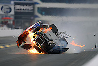 Sept. 16, 2012; Concord, NC, USA: NHRA pro stock driver Shane Gray crashes on fire during the O'Reilly Auto Parts Nationals at zMax Dragway. Gray would be uninjured. Mandatory Credit: Mark J. Rebilas-