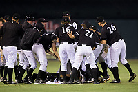 The Kannapolis Intimidators celebrate after their come from behind walk-off win against the Hickory Crawdads at Kannapolis Intimidators Stadium on April 22, 2017 in Kannapolis, North Carolina.  The Intimidators defeated the Crawdads 10-9 in 12 innings.  (Brian Westerholt/Four Seam Images)