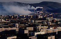 Smoke plumes fill the crisp Siberian artic air from a nickel mine in Norilsk. Pollution can be seen from satellites. It is one of the most polluted places in the world.